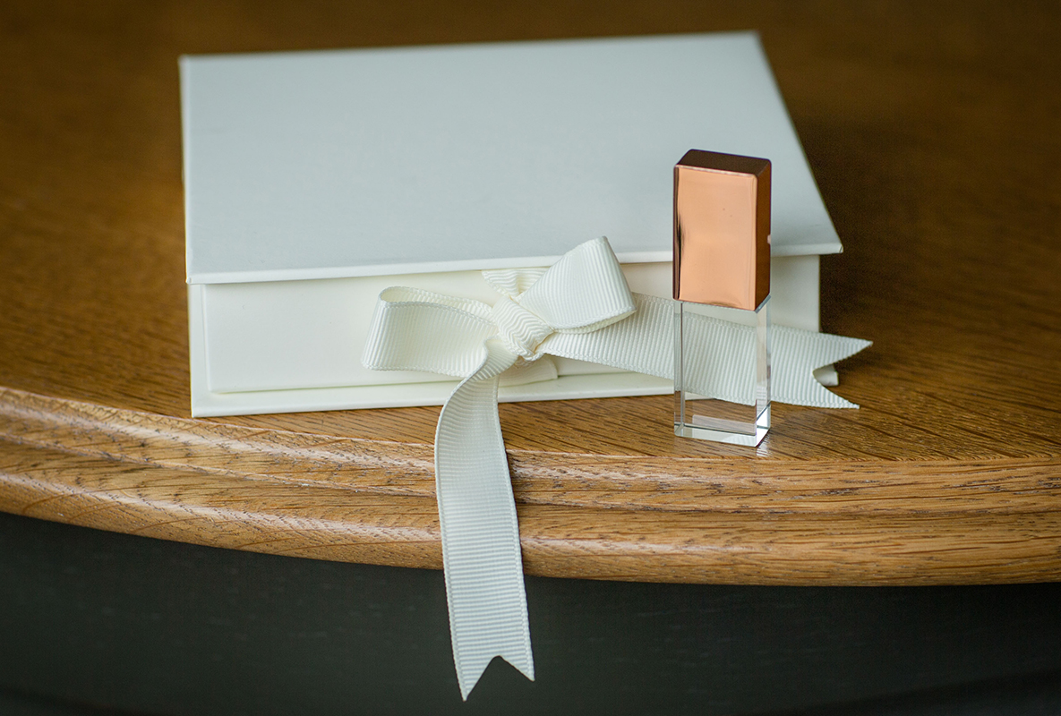 Rose gold crystal USB with ivory ribbon tied presentation box