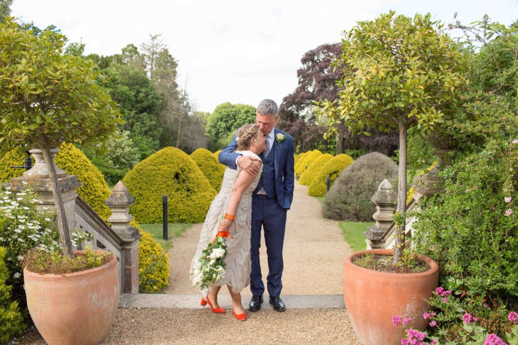 Manor by the Lake, Wedding, Cheltenham, Bride Groom Grounds Stairs Large Plants