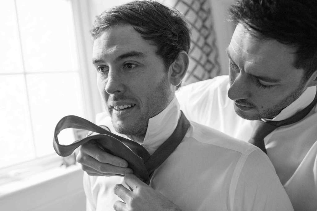 Kings Head Hotel Winter Wedding, Cirencester, Groom Best Man Tying Ties