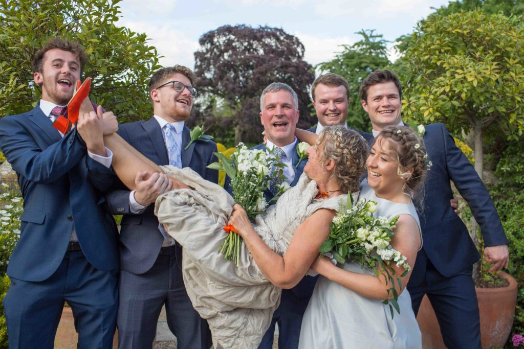 Manor by the Lake, Cheltenham, Wedding, Bridesmaid Groomsmen Holding Up Bride