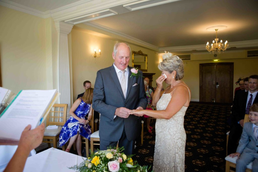 Stanton House Hotel, Swindon, Groom Putting on Ring Bride Tears