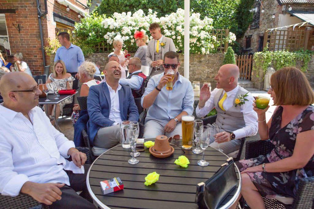 Highworth Hotel, Swindon, Wedding Guests Sat Drinking Laughing