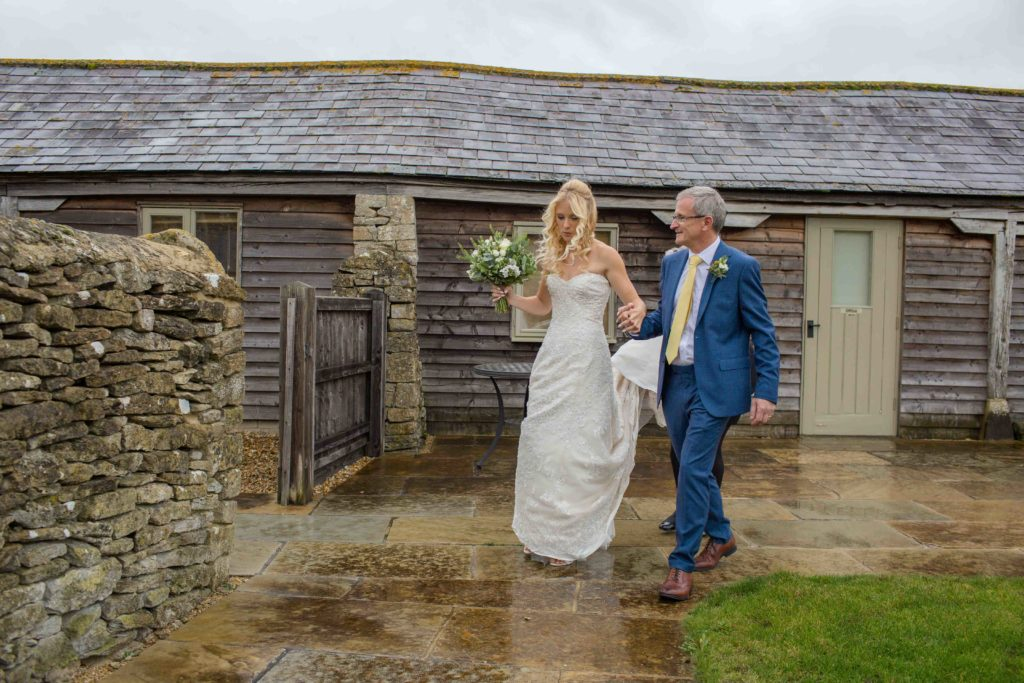 Caswell House, Oxfordshire, Ceremony Bride Father Bride Walking Outside Stone Wall Gate