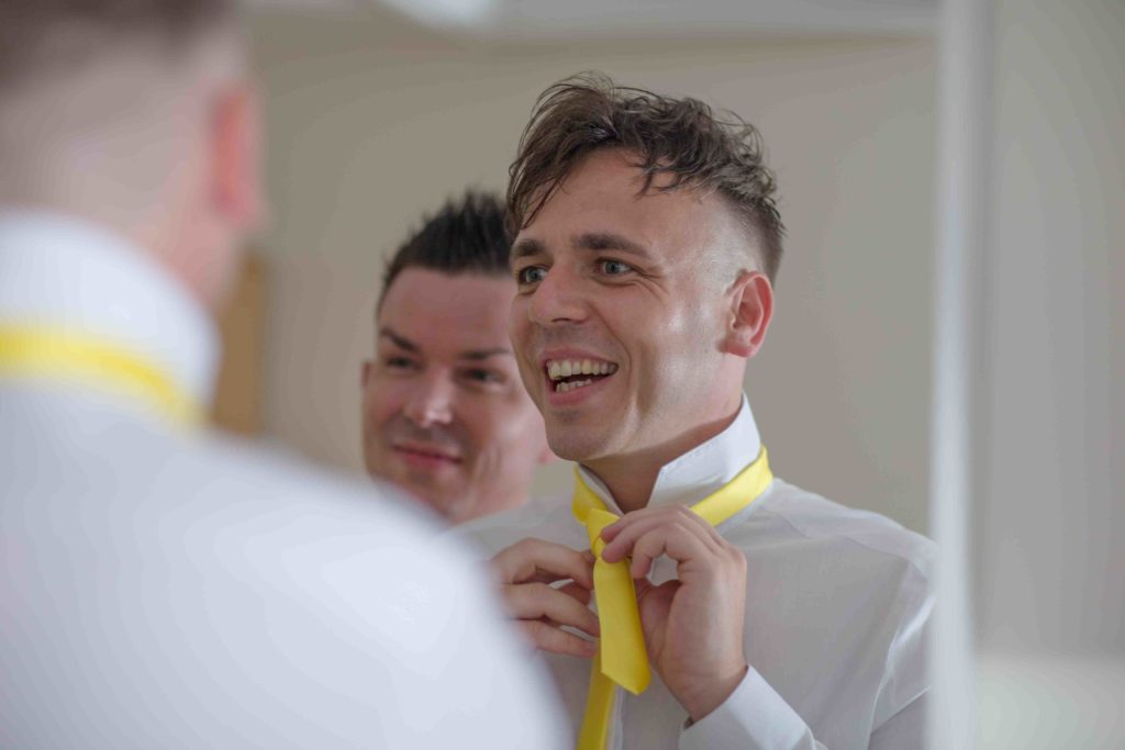 Highworth Hotel, Swindon, Wedding Groom Groom Adjusting Tie in Mirror