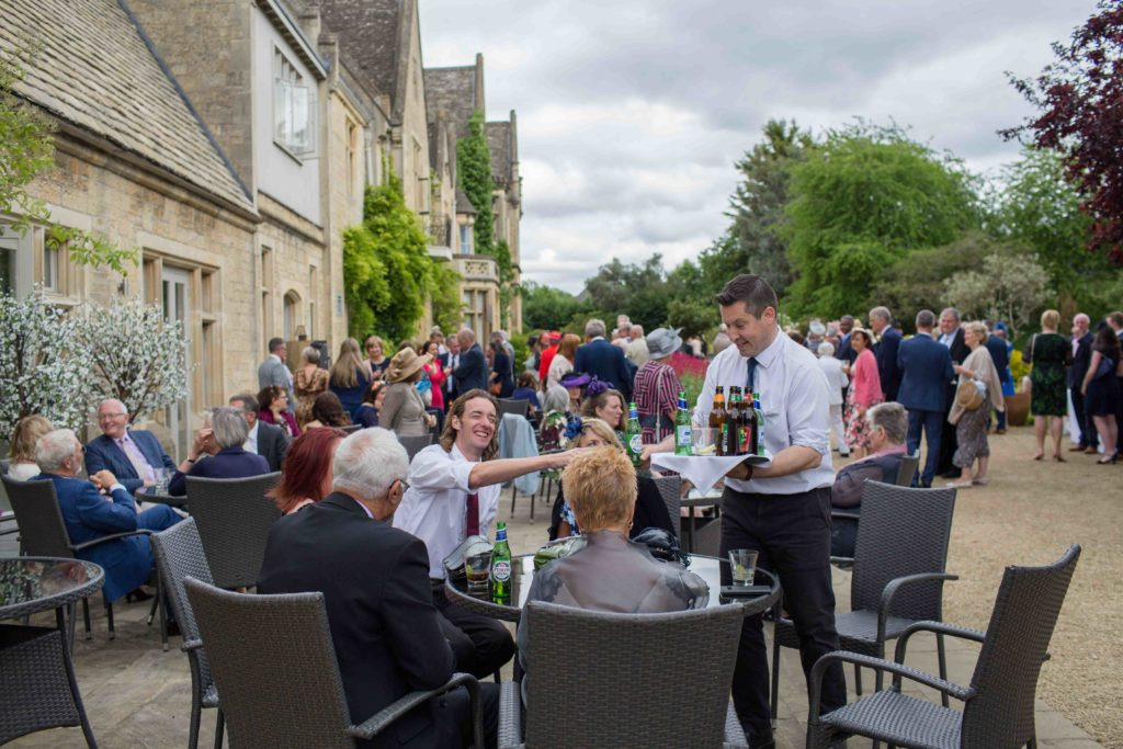 Manor by the Lake, Cheltenham, Wedding, Outdoors Guests Being Served Drinks