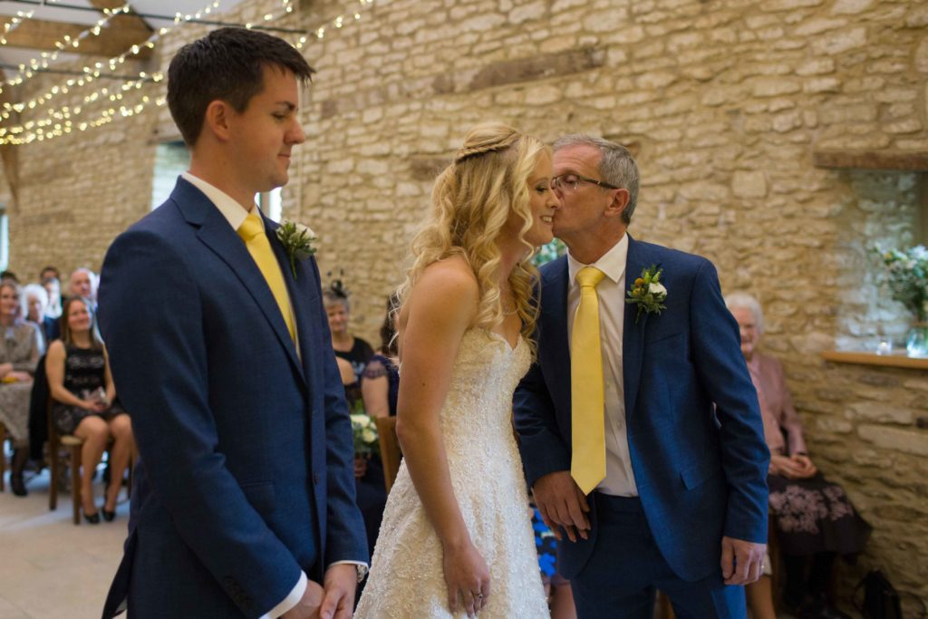Caswell House, Oxfordshire, Bride Groom Ceremony Father Bride Kissing Cheek Bride