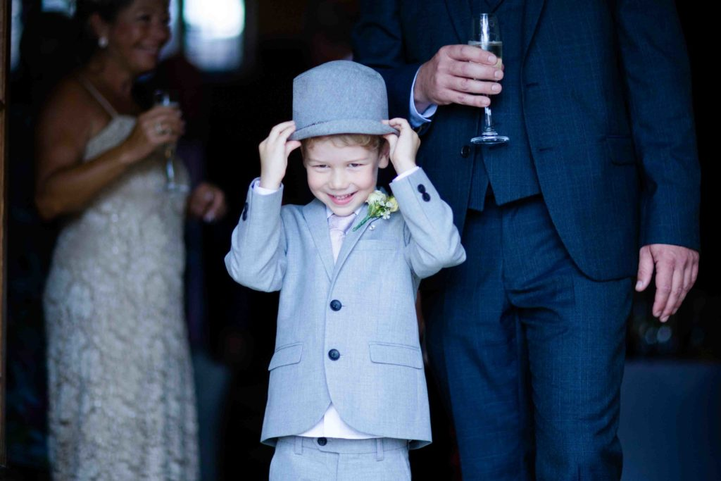 Stanton House Hotel, Young Guest Holding Hat