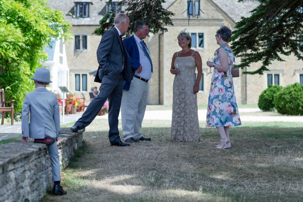 Stanton House Hotel, Swindon, Summer Wedding, Bride Guests Chatting Low Wall