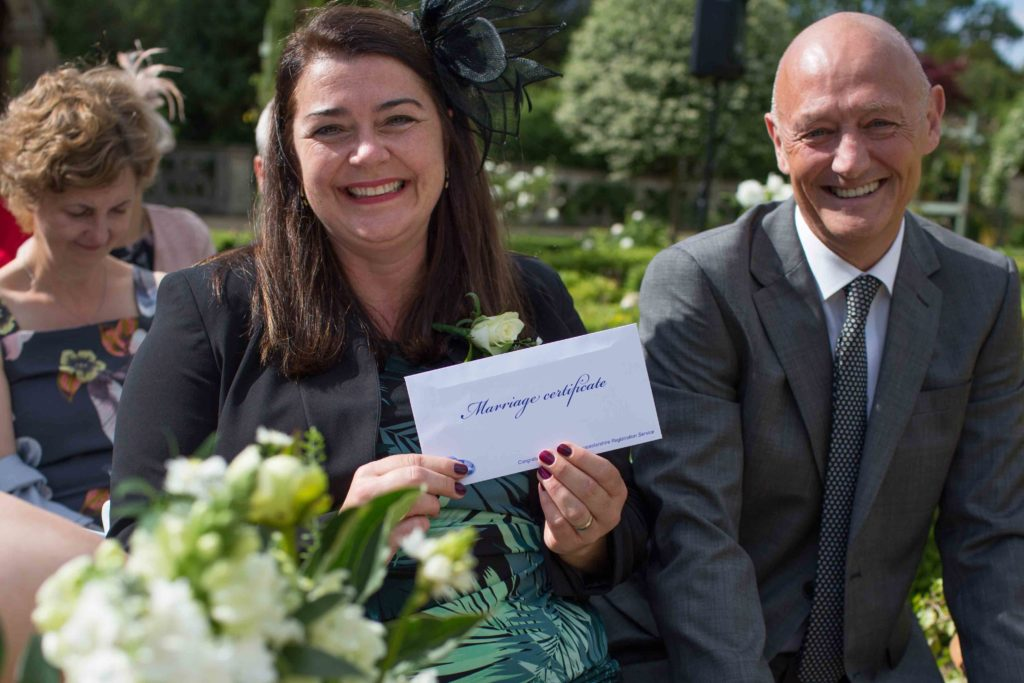 Manor by the Lake, Cheltenham, Wedding, Guest Holding Wedding Certificate