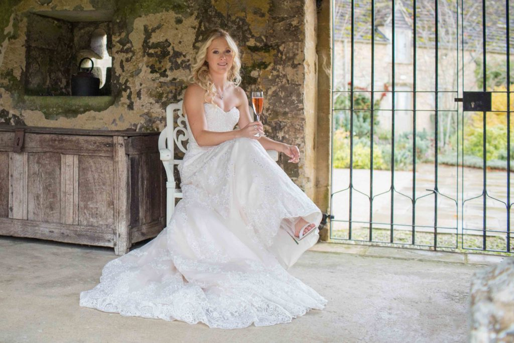 Caswell House, Oxfordshire, Bride Sat Chair Champagne Glass