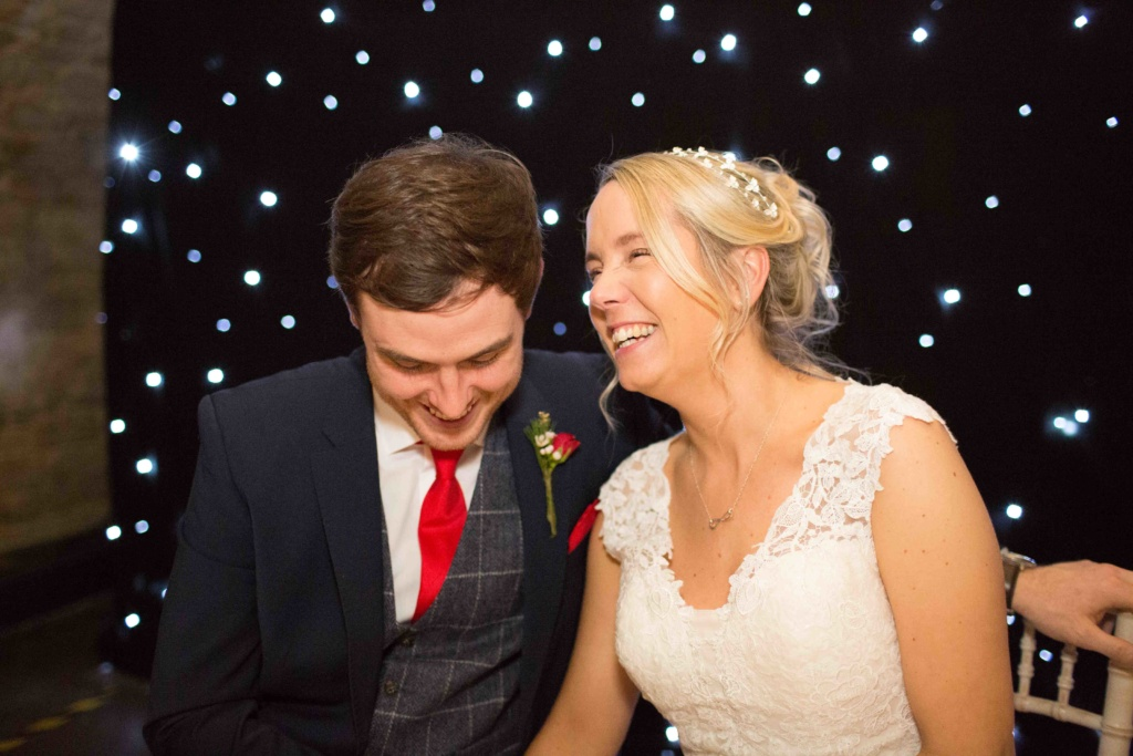 Kings Head Hotel Winter Wedding, Cirencester , Bride Groom Smiling Seated Ceremony