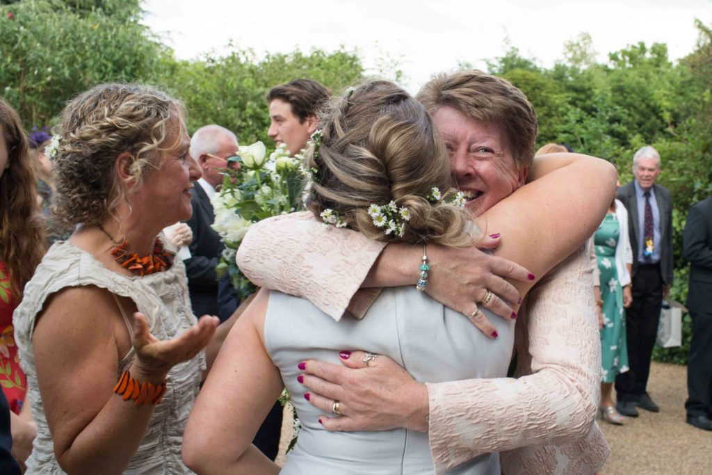 Manor by the Lake, Cheltenham, Wedding, Bride Bridesmaid Guest Hugging
