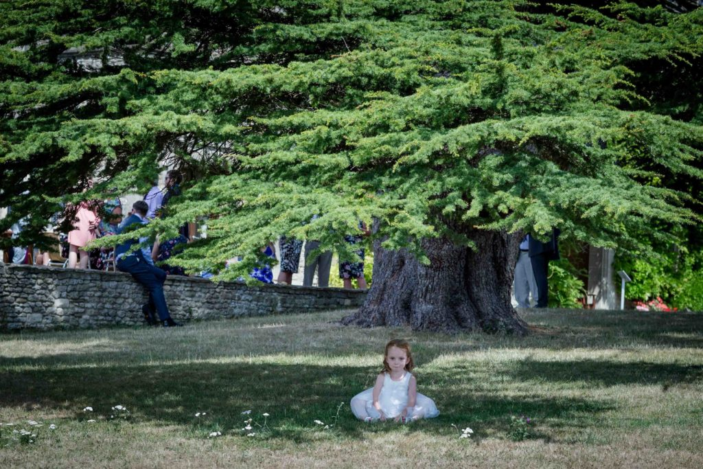Stanton House Hotel, Swindon, Summer Wedding, Young Bridesmaid Sat Under Tree