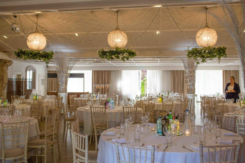 Manor by the Lake, Cheltenham, Wedding, Dining Area Tables Laid Lights Flowers