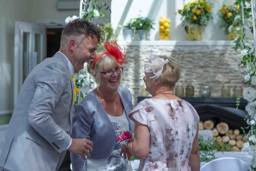 Highworth Hotel, Swindon, Wedding Groom Guests Laughing
