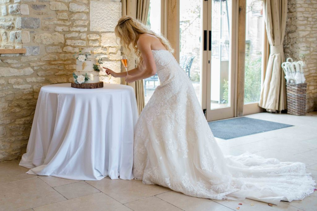 Caswell House, Oxfordshire, Bride Glass Champagne Touching Cake