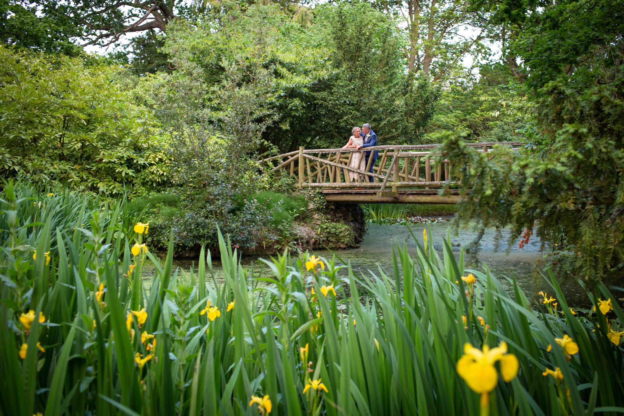 Manor by the Lake, Cheltenham, Wedding, Bride Groom Grounds on Wooden Bridge