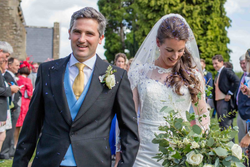 Wedding Photography, Mintridge, Herefordshire, Bride and Groom Leaving Ceremony looking very happy