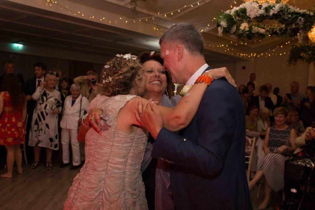 Manor by the Lake, Cheltenham, Wedding, Bride Groom Guest Hug Dance Floor