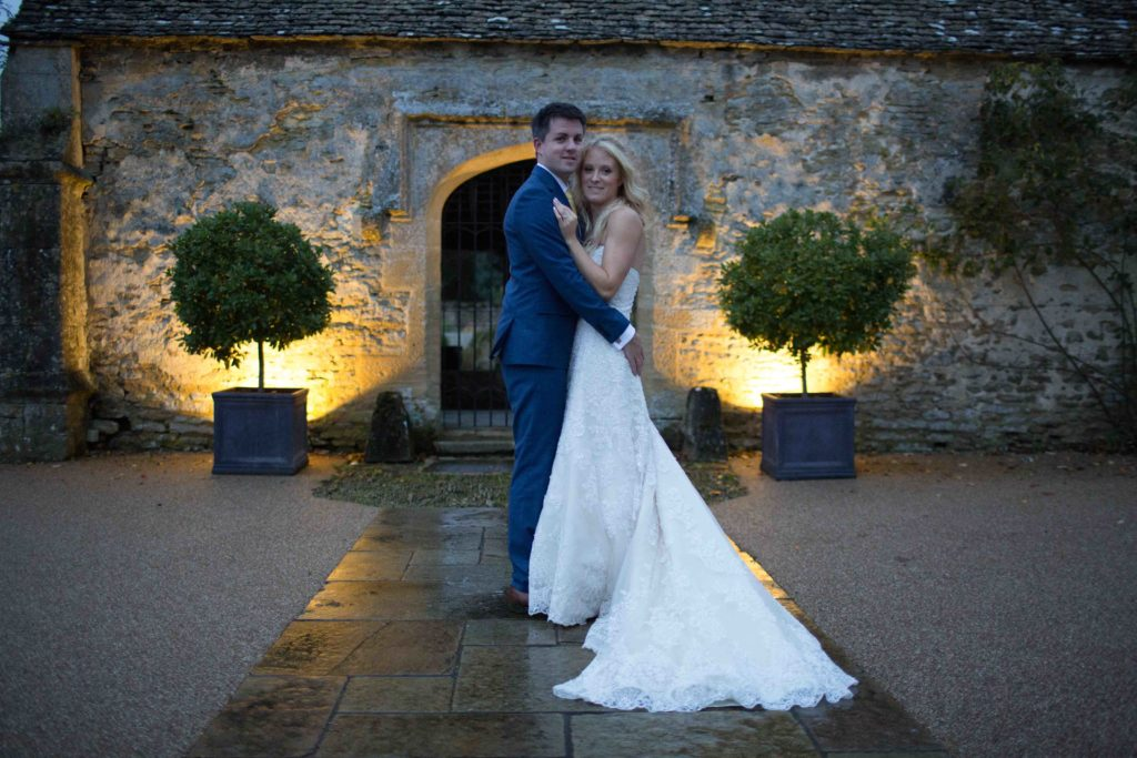 Caswell House, Oxfordshire, Bride Groom Hugging Outside Evening
