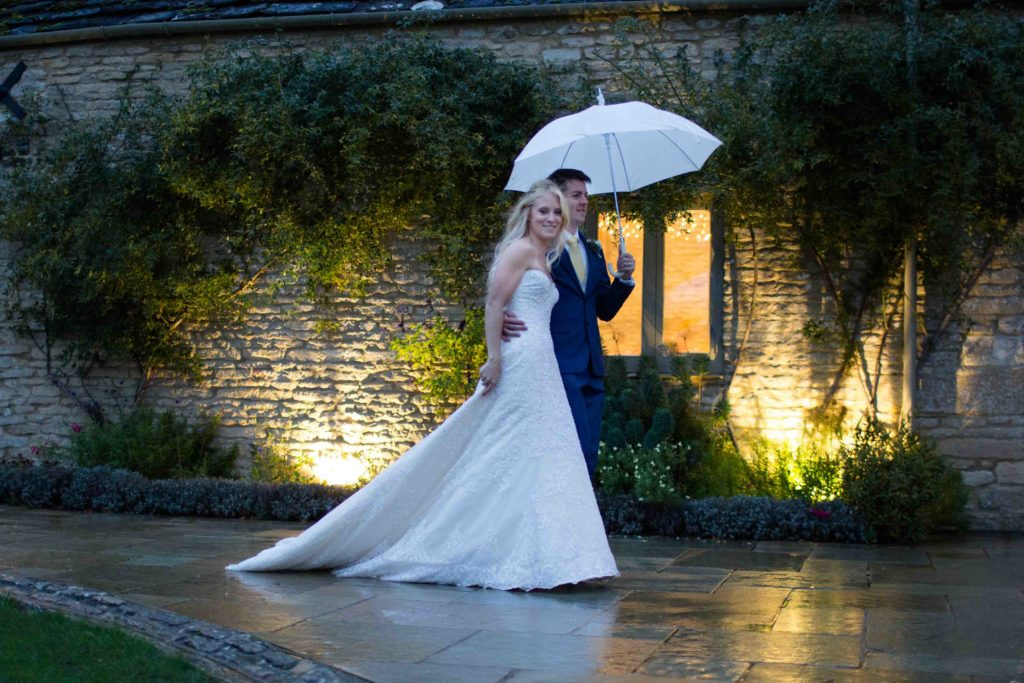 Caswell House, Oxfordshire, Bride Groom Umbrella Outside