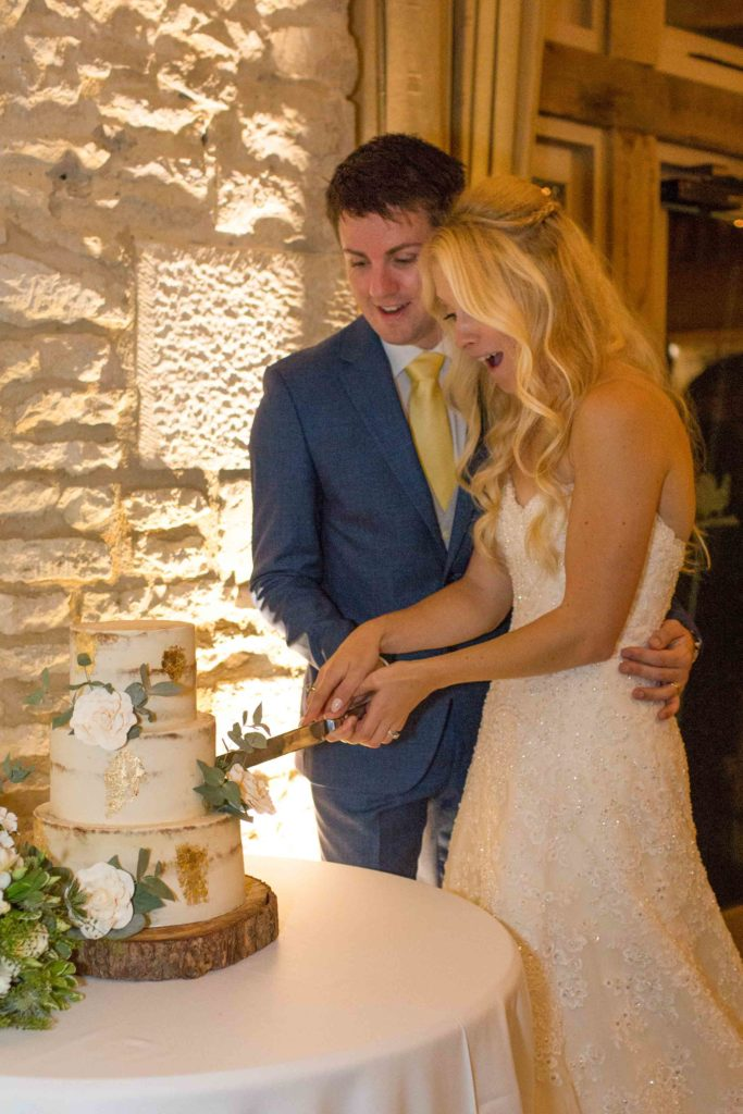 Caswell House, Oxfordshire, Bride Groom Cutting Cake