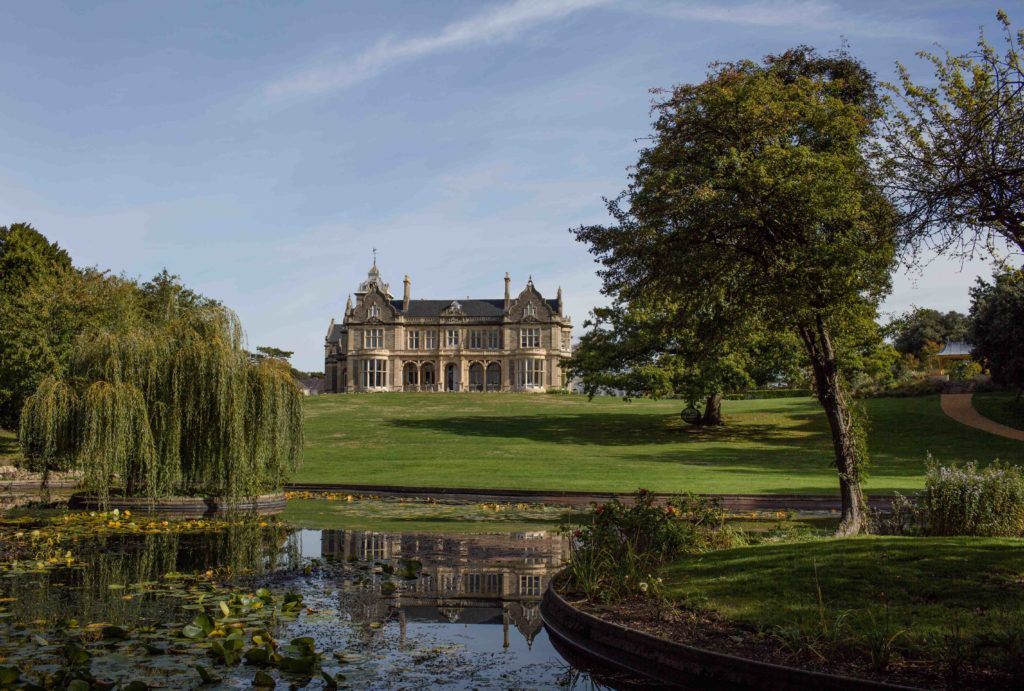 Clevedon Hall, with the lake in the foreground and sweeping lawn running up to the hall