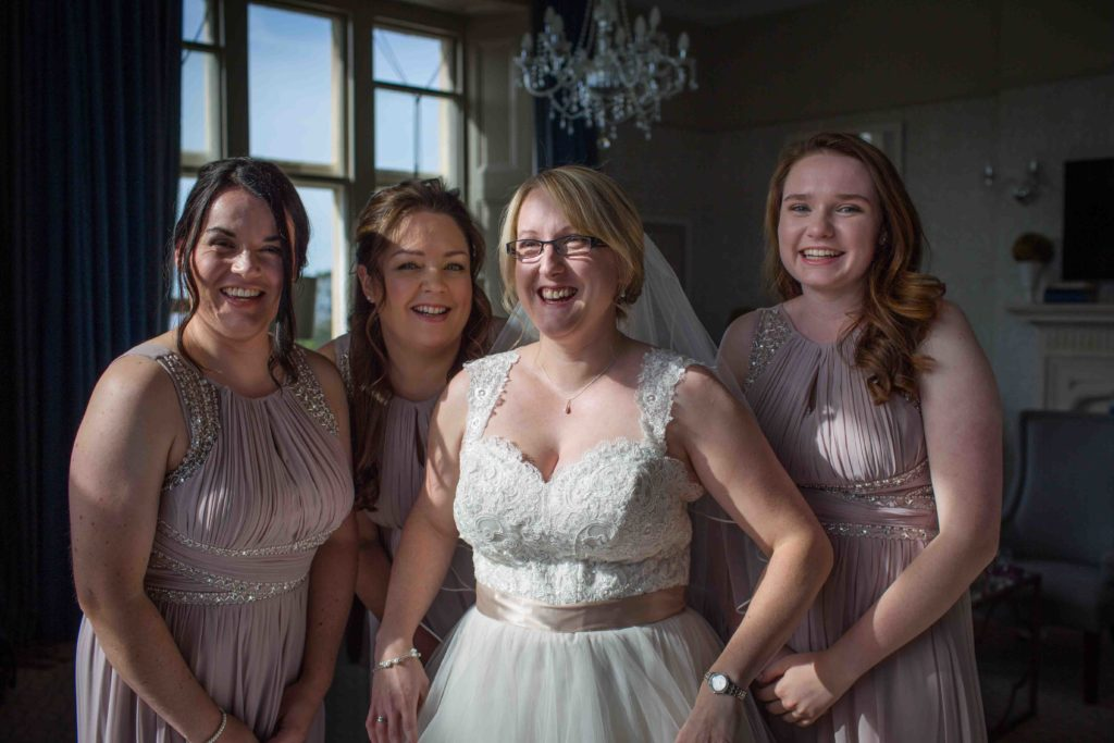 Clevedon Hall, Wedding, Bride in wedding gown with her maid of honour and bridesmaids dressed in lilac dresses