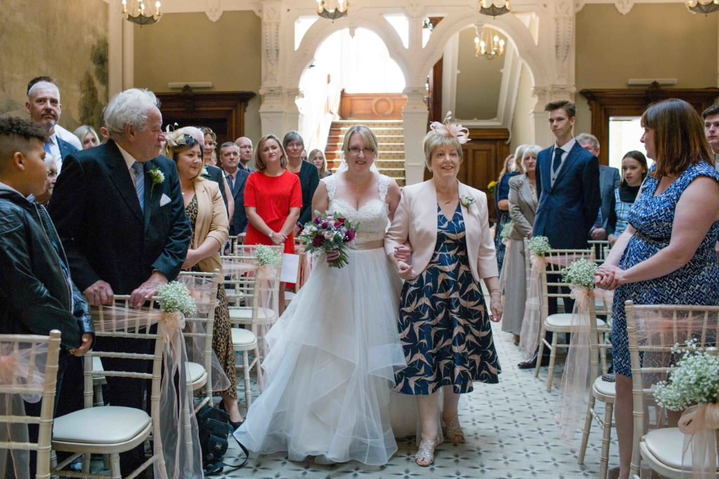 Clevedon Hall, Wedding, Bride walking up aisle holding arm of her mother