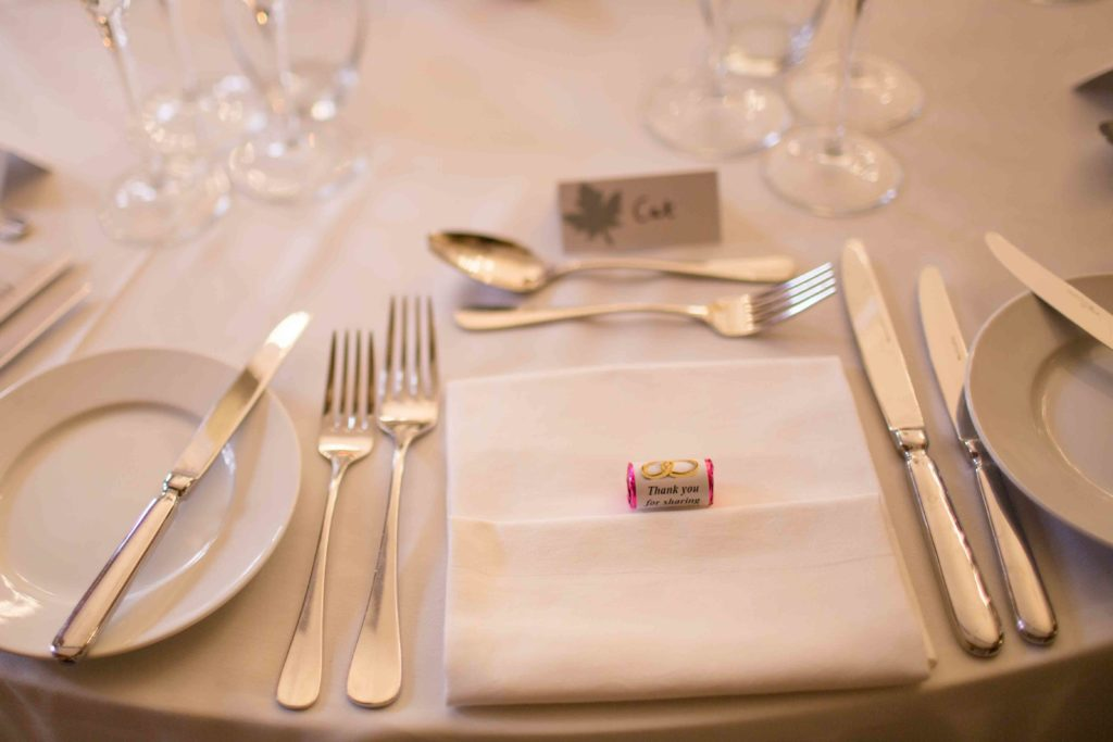 Clevedon Hall, dining area elegantly laid out for a wedding, close up of place setting