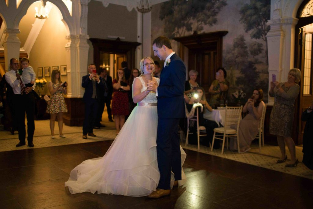 Clevedon Hall, Bride and Groom first dance in beautiful hall with dark wooden floor