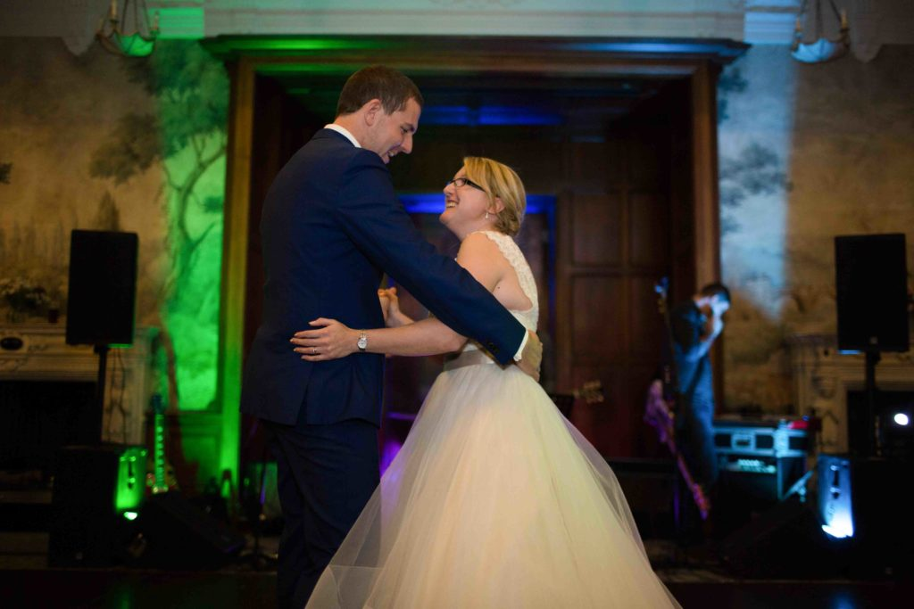 evedon Hall, Bride and Groom, looking into each others eyes, first dance in beautiful hall with dark wooden floor,
