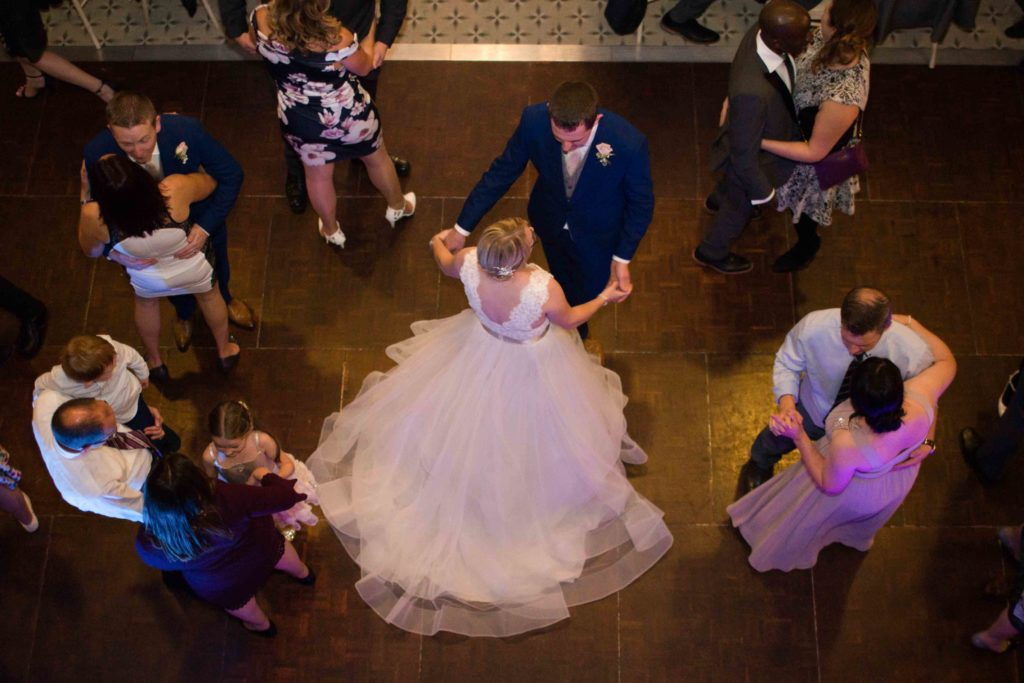 Cevedon Hall, From above, Groom twirling bride around in first dance, guest joined in, beautiful hall with dark wooden floor
