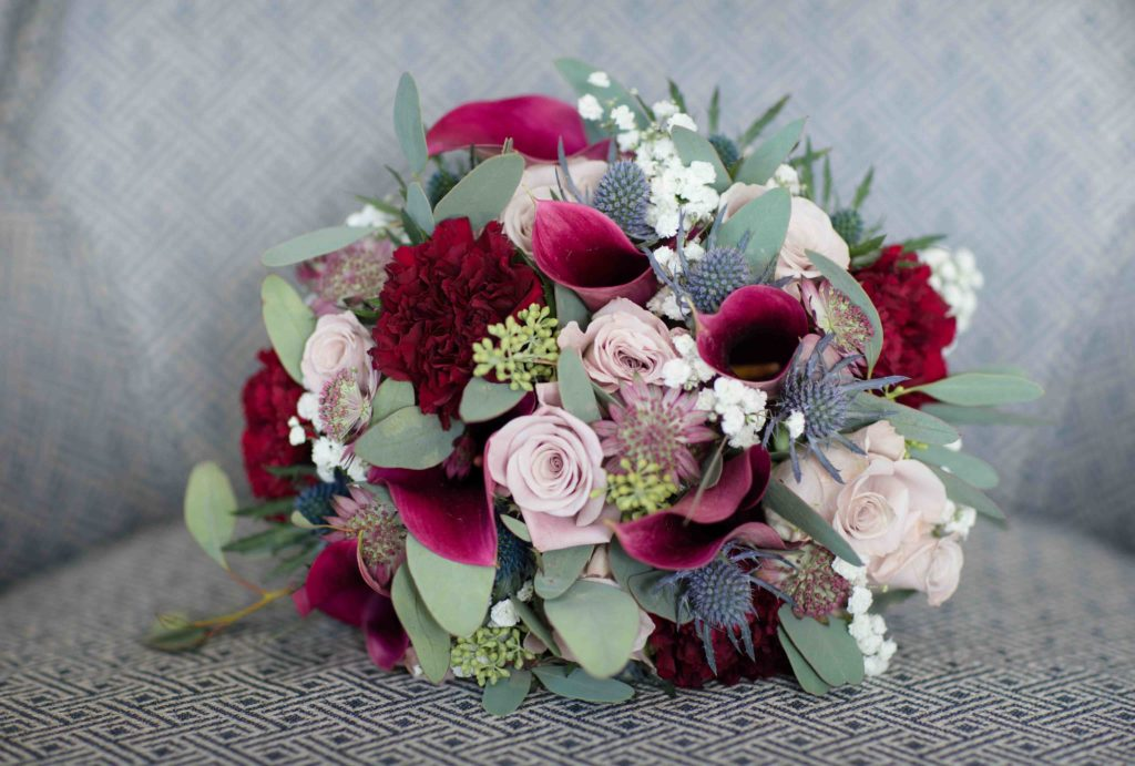 Wedding Bouquet, Pink and white roses with  green and white foliage.
