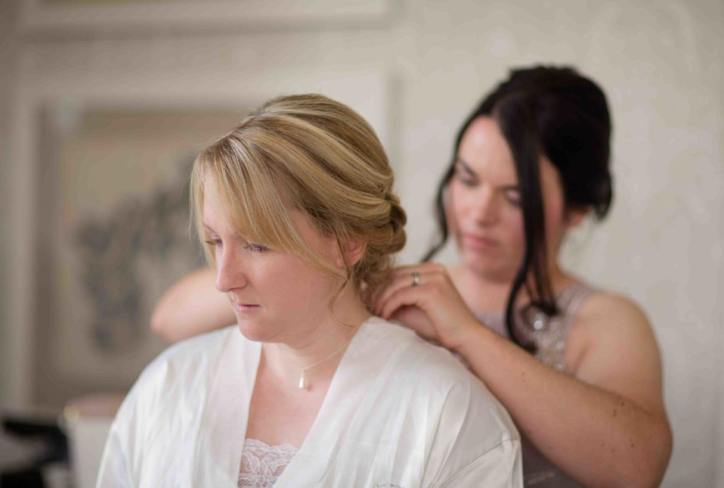Clevedon Hall, Wedding, Bride dressed in silk dressing gown having her hair done.