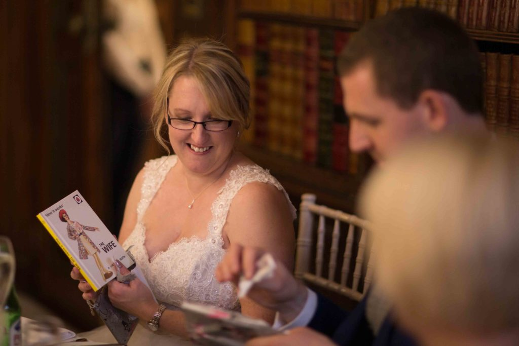 Bride and Groom sat looking at some of the lovely cards they have been given