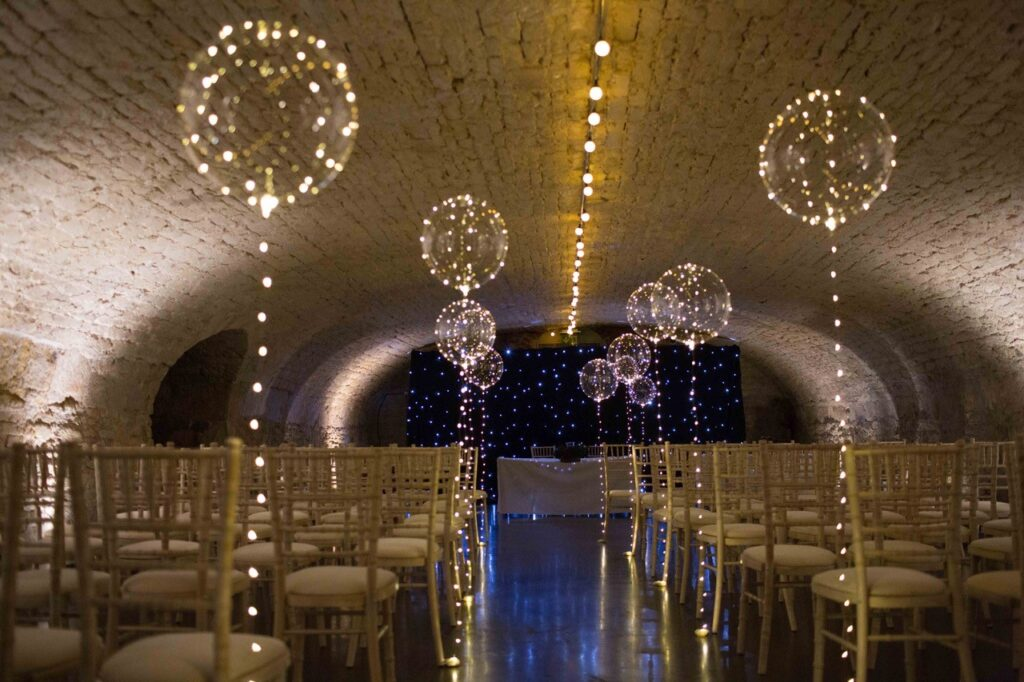 Kings Head, Vaulted Wine Cellar, set up for wedding, cream chairs and balloons